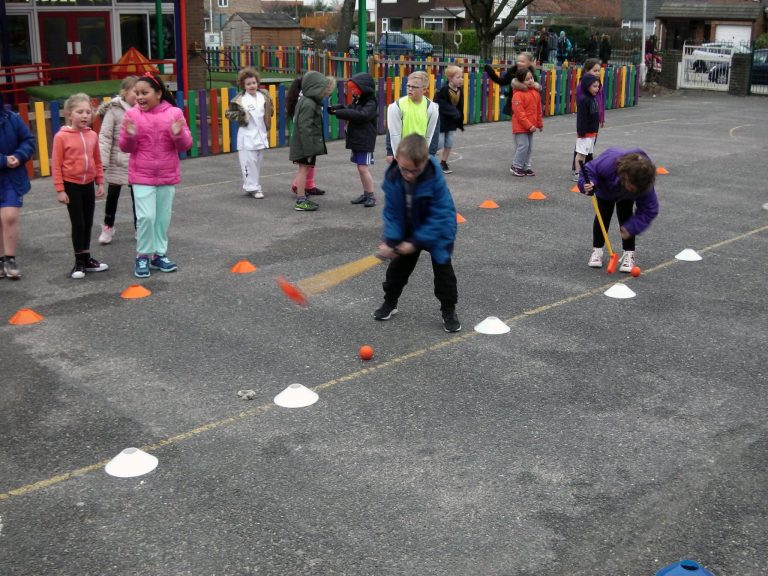 Image #7 of Kelly Bridges Golf Instructor running a Tri-Golf session for primary school children in the school playground.