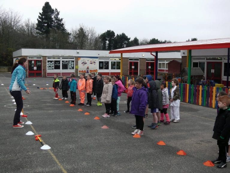 Image #6 of Kelly Bridges Golf Instructor running a Tri-Golf session for primary school children in the school playground.