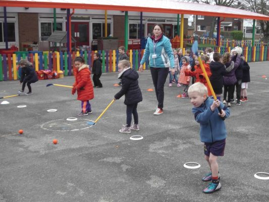 Image #5 of Kelly Bridges Golf Instructor running a Tri-Golf session for primary school children in the school playground.