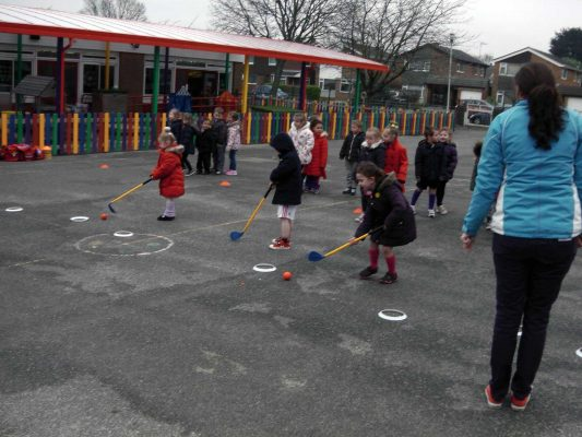 Image #4 of Kelly Bridges Golf Instructor running a Tri-Golf session for primary school children in the school playground.