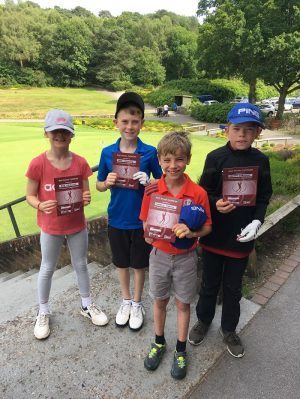 Kelly Bridges Golf - image of-proud-junior-academy-kids-with-golf-access-certificates